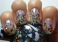 Clear based polish with black and silver holographic hex glitter