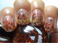 Orange and black bar glitter with small multi-colored hex glitter in a clear base